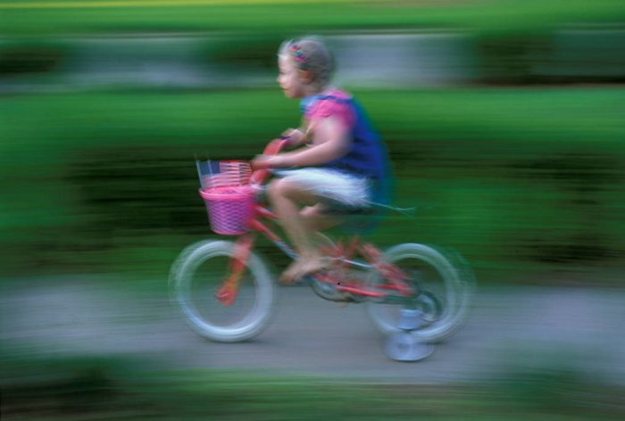 Photo: Ellen Sartore on her bicycle (Nebraska).