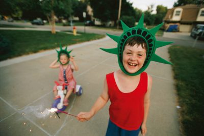 Photo: Cole and Ellen Sartore celebrate Independence Day outside their home in Lincoln, Nebraska.