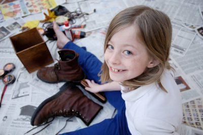 Photo: Ellen Sartore shines her father's shoes for the low, low price of $1/pair outside her home in Lincoln, Nebraska.