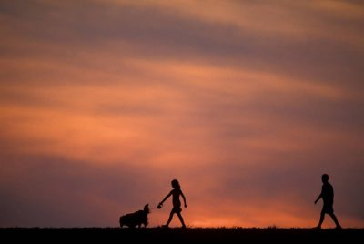 Photo: Cole and Ellen Sartore walk their family dog along Holmes Lake Dam in Lincoln, NE.