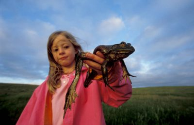 Photo: Ellen Sartore and her pet frog in Lincoln, NE.