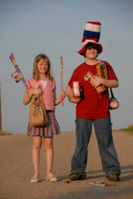 Photo: Cole and Ellen Sartore with their Fourth of July arsenal.