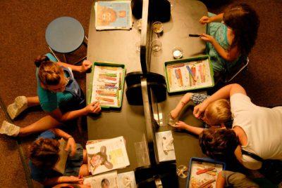Photo: Volunteers at the Lincoln Children's Museum in Nebraska paint children's faces.