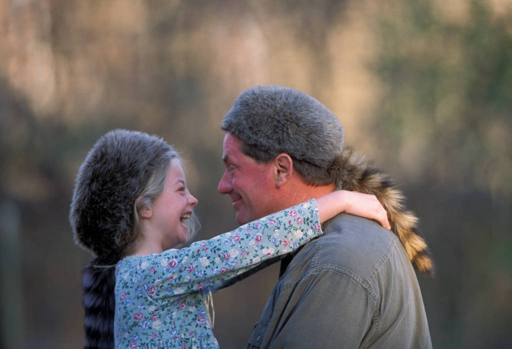 Photo: Ellen Sartore and her father, Joel sport matching (fake) coonskin caps in Lincoln, NE.