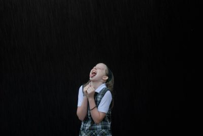 "Photo: Ellen plays in ""rain"" from a sprinkler at her home in Lincoln, NE."