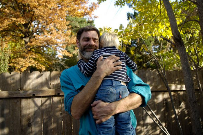 Photo: A man and his three-year-old son at their Nebraska home.