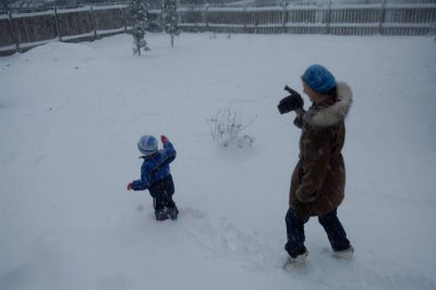 Photo: A mother videotapes her 3-year-old child outside after a snowstorm in Lincoln, Nebraska.