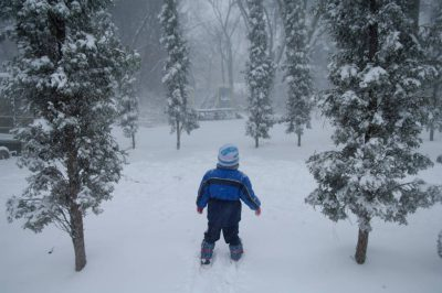 Photo: A child plays outside after a snowstorm in Lincoln, Nebraska.