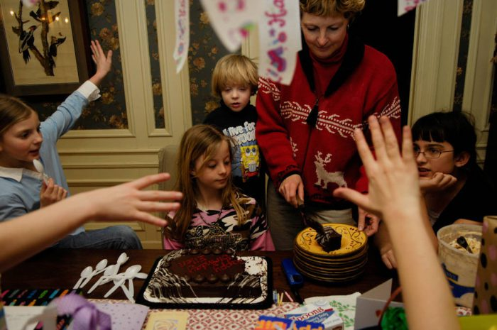 Photo: A girl's mother serves cake at her tenth birthday party.