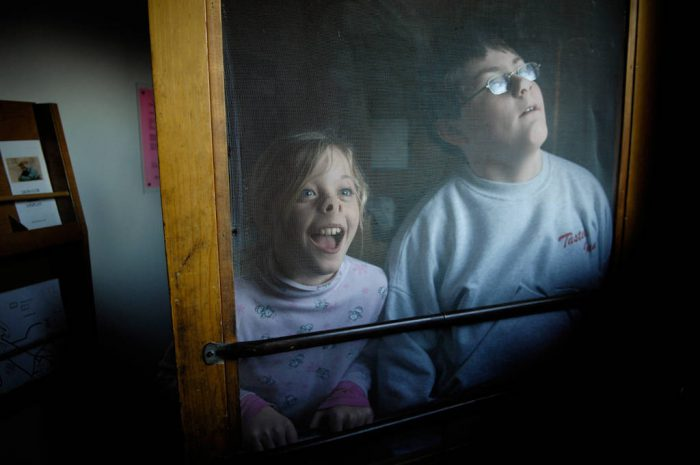 Photo: A young girl and boy stand in front of a screen at the 4-H Photo Camp at Halsey, NE.