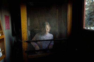 Photo: A young girl stands in front of a screen at the 4-H Photo Camp at Halsey, NE.