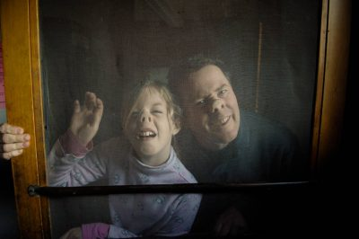 Photo: A young girl and her father stand in front of a screen at the 4-H Photo Camp at Halsey, NE.