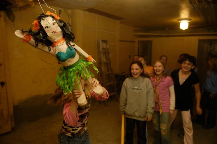 Photo: Friends break a pinata at a 10-year-old's birthday party.