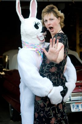 Photo: A woman protests having her picture taken with a mischievous Easter bunny.