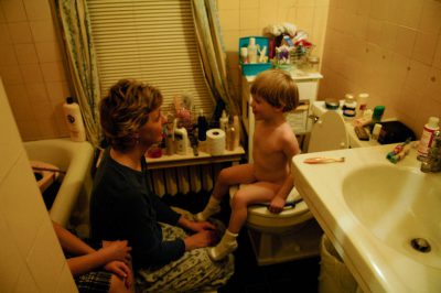 Photo: A woman tries to potty train her three-year-old son.