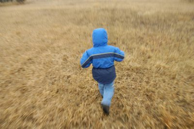 Photo: A bundled up three-year-old runs in a field in Lancaster County.