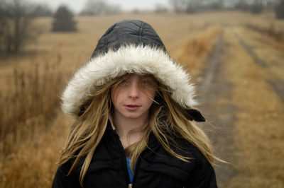 Photo: A young girl stands in a field in Lancaster County.