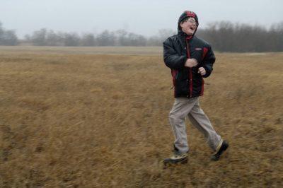 Photo: A young boy runs through a field in Lancaster County.