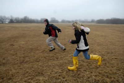 Photo: A young boy and girl run through a field in Lancaster County.