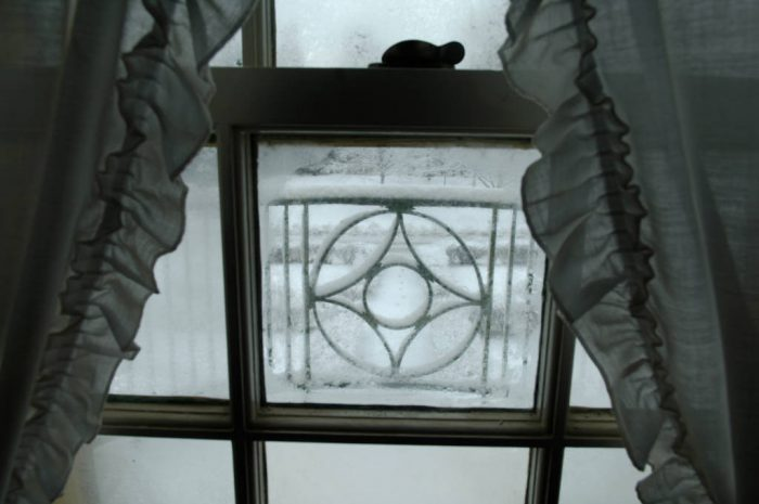 Photo: A backyard covered with snow is seen through a window after a snowstorm.