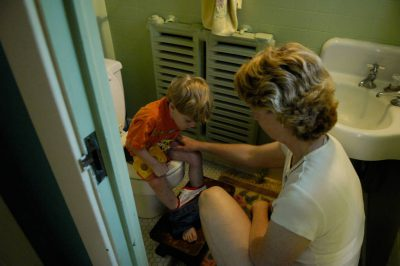 Photo: A boy learns how to use the bathroom