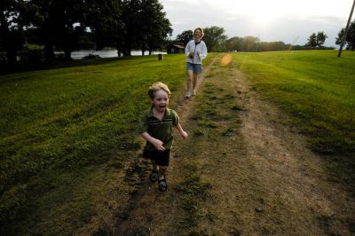 Photo: A mother chases her 3-year-old son down a dirt road at a scout camp near Humbolt, Nebraska.