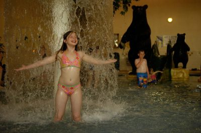 Photo: A girl stands under a waterfall at an indoor pool in Prairie du Chien, Wisconsin.