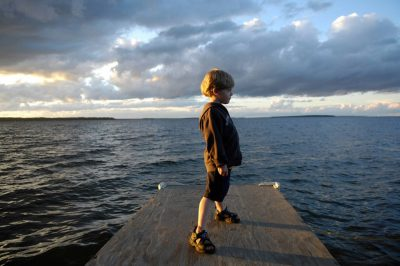 Photo: A young boy at dusk at Leech Lake in Minnesota.