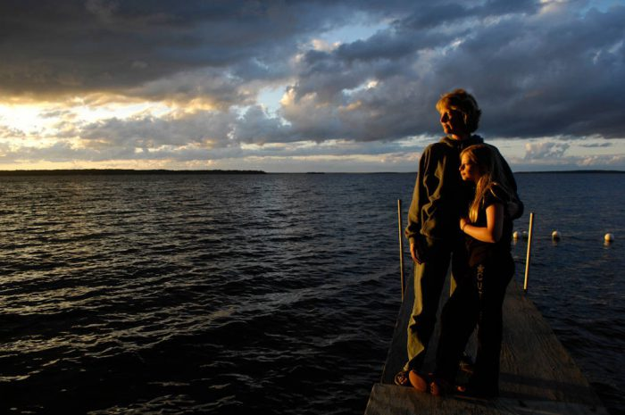 Photo: A mother and her daughter at dusk at Leech Lake in Minnesota.