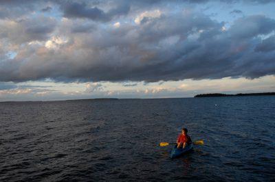 Photo: A boy in a canoe at Leech Lake in Minnesota.
