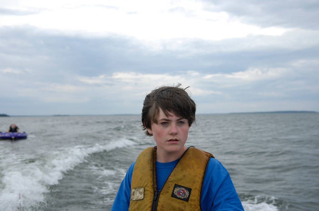 Photo: A teenage boy drives a boat around Leech Lake in Minnesota.