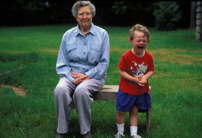 Photo: A young boy and his great-grandmother spend quality time together.