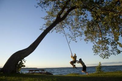 Photo: Two boys play on a rope swing along the shores of Leech Lake, Minnesota.