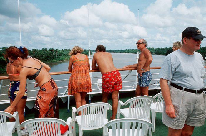 Photo: Tourists survey the Amazon River from the decks of a cruiseship.