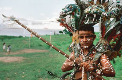Photo: A local villager dresses up for tourists from the cruise ships that travel down the Amazon River (Brazil.)