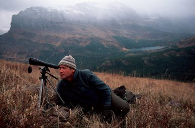 Photo: Backpacker sightseeing in Glacier National Park.