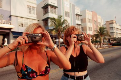 Photo: Tourists photograph Miami's South Beach art deco district.