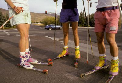 Photo: Three men train for cross-country skiing on roller skis at Sun Valley, Idaho.