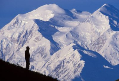 Photo: A hiker silhouetted in front of Mount McKinley in Denali National Park, Alaska.