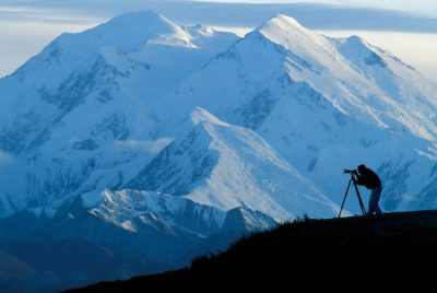 Photo: A hiker photographs the view of Mount McKinley in Alaska's Denali National Park.