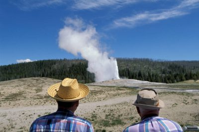 "Photo: Tourists at Yellowstone National Park's ""Old Faithful"" geyser."