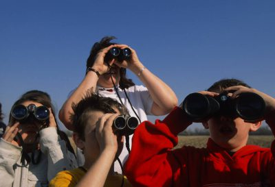 Photo: Students interact with nature on a field trip to Rowe Audubon Sanctuary near Gibbon, Nebraska.