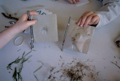 Photo: Students work on a nature craft project on a field trip to Rowe Audubon Sanctuary near Gibbon, Nebraska.