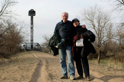 Photo: A couple stands in front of a bird blind at Rowe Sanctuary near Gibbon, Nebraska.