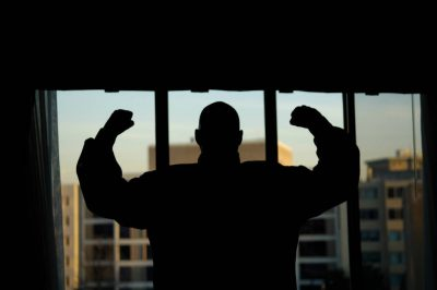 Photo: A man shows off his muscles in a hotel room in Washington, DC.