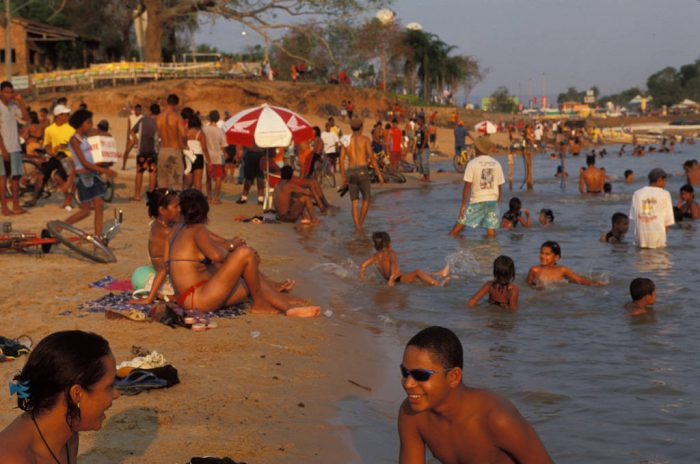Photo: Brazilians at a beach in Caceres on Paraguay River.