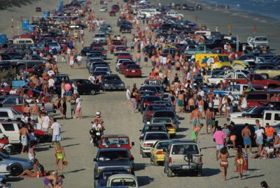 Photo: Aerial view of Galveston Island, Texas where students on spring break crowd the beach.
