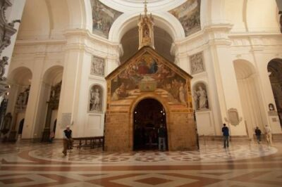 Photo: The Porziuncola, a church restored by St. Francis of Assisi, and the place where he first understood his vocation and renounced the world, inside the Basilica of Santa Maria degli Angeli in Assisi, Italy.