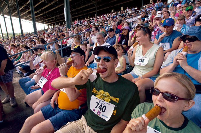Photo: Iowa fairgoers bite in synchrony at the first-ever Corn Dog Chomp.