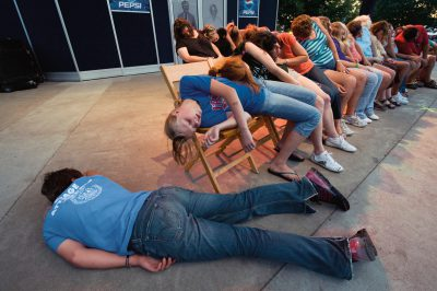 Photo: Volunteers go catatonic at the snap of a hypnotist's fingers at the Iowa state fair.